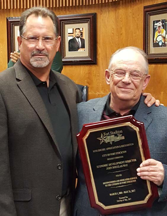 Former EDC Director Doug May receives a plaque for his service to the community from Mayor Alexander.
