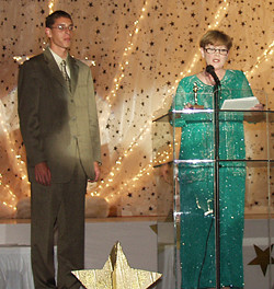 In an Pioneer file photo FSHS Principal Alice Duerksen introduces 2002 Outstanding Young Citizen Bjorn Subia at the Chamber Banquet last Thursday evening.   Pioneer photo by Joni McGee
