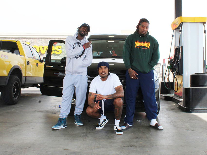 Record Producer Eldee stands with rappers Poodezeey and Mack Twon outside of the Love's Travel Stop as the group prepares for their first day off from touring.