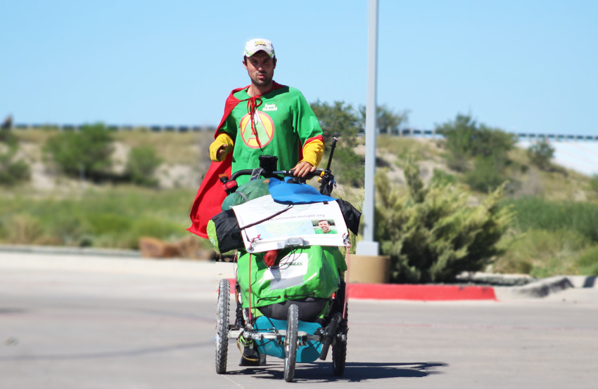 "Wearing his self-described ""Adventureman"" costume, Jamie McDonald arrives at the Fairfield Inn & Suites in Fort Stockton. He is traveling across the U.S. on foot to raise money for children's charities."