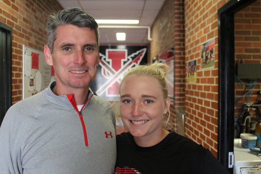 Iraan High School senior Corbi Maurer, right, is the Permian Basin's lone semifinalist for the National Merit Scholarship Program. She is shown with her father, Corby Maurer , who si the head football coach at the school.
