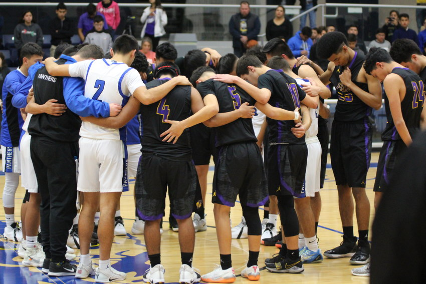 Players from Fort Stockton and Pecos high schools gather for a moment of silence and prayer prior to their Tuesday, Jan. 29 game in Fort Stockton. The moment of silence was held for two Pecos student-athletes  – Jonathan Aguilar and Ethan Medina – who died in a car crash one week earlier.