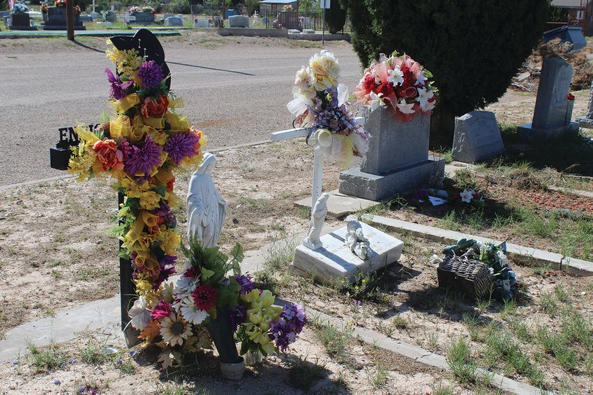 Before the clean up, many grave sites were adorned with flowers and personal items.