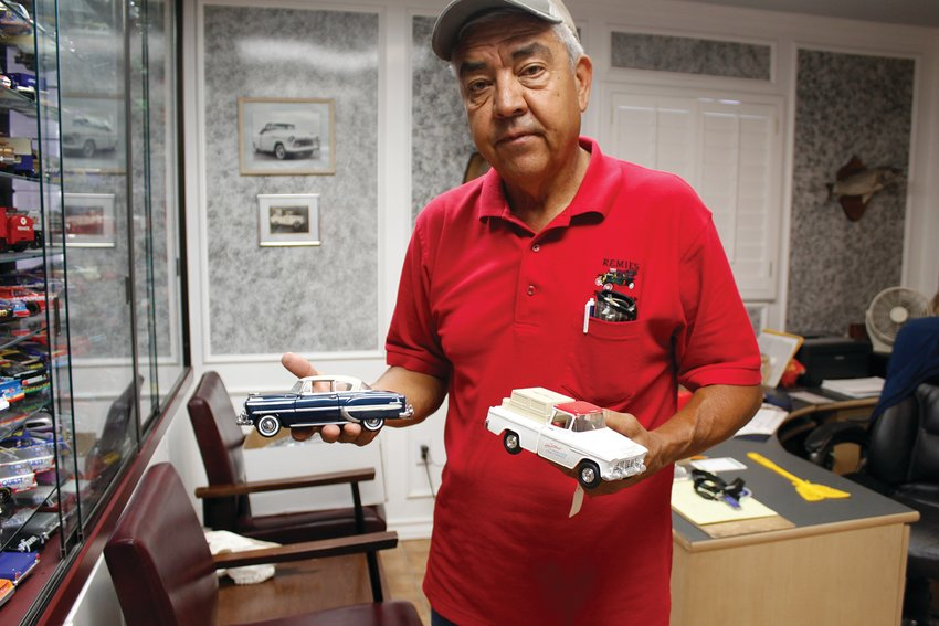 Ramiro Ramos took over the family business and displays his model cars. These two are special to him because they show cars that they rebuilt when his dad was alive.