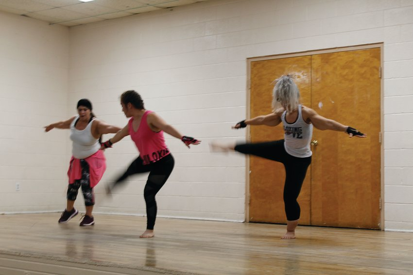 Demonstration of the new Piloxing class at Pecos County Memorial Hospital gym.