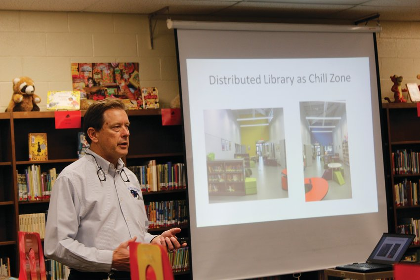 Superintendent Ralph Traynham showed the attendees several power points to get support for the project.