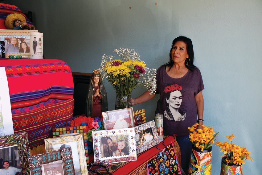 Amy Terrazas stands by the alter she decorated to celebrate her late husband Pete.