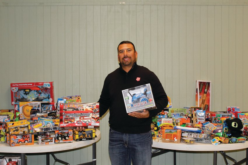 Domingo Escontrias had tables of new toys for children in the community who may go without.