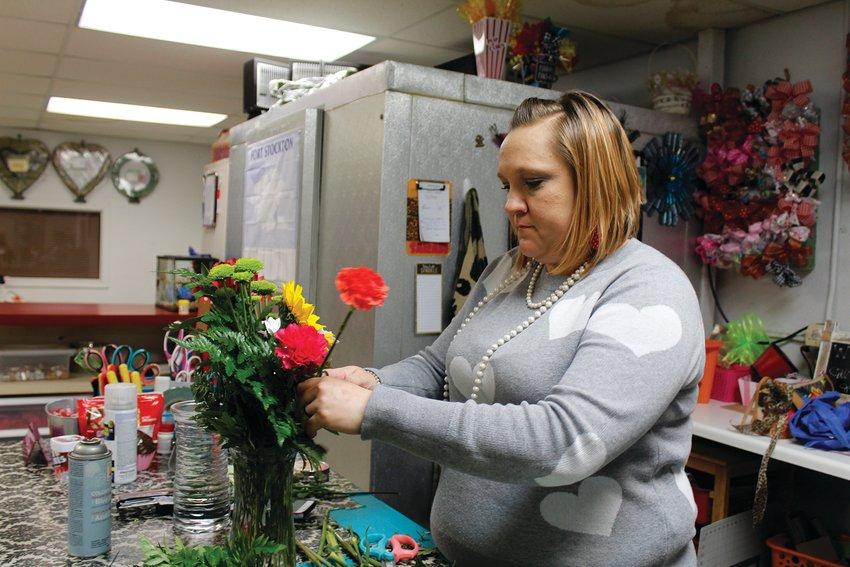 Sarah Smith creating a bouquet.