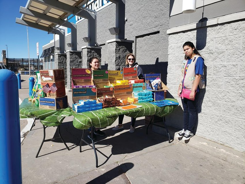 L-R, Hermione Sandoval, Abby Frank and Jazlin Ontiveros sell cookies outside of the store.