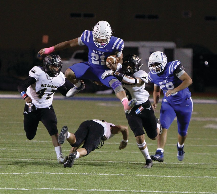 Fort Stockton quarterback Dominic Aguilar hurdles a Big Spring defender during Friday's Senior Night game against the Steers. Aguilar ran for a team-high 118 yards on 16 carries.