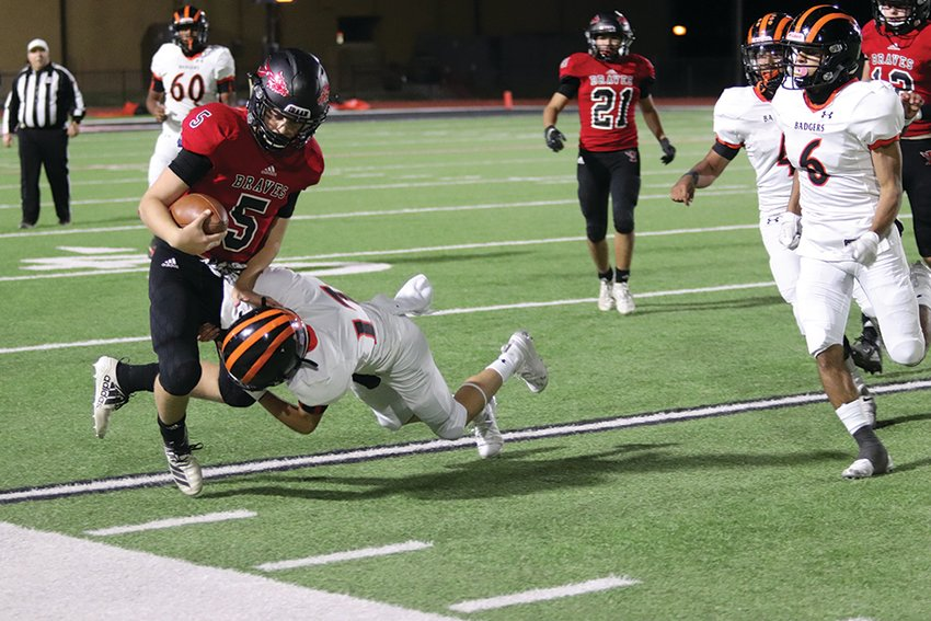 Iraan's Braden Kent runs through a tackle on Friday, Oct. 23 during the Braves homecoming game vs. McCamey.