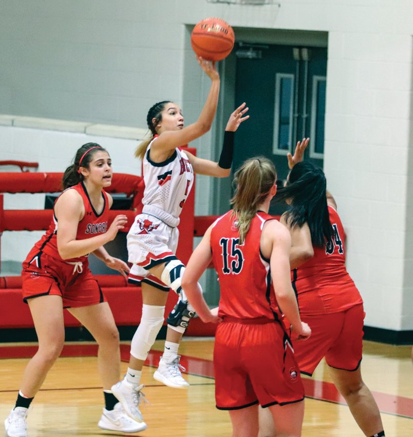 Iraan's Madison Gallegos releases a floater during the Braves matchup with Sonora on Tuesday, Nov. 17 in Iraan.
