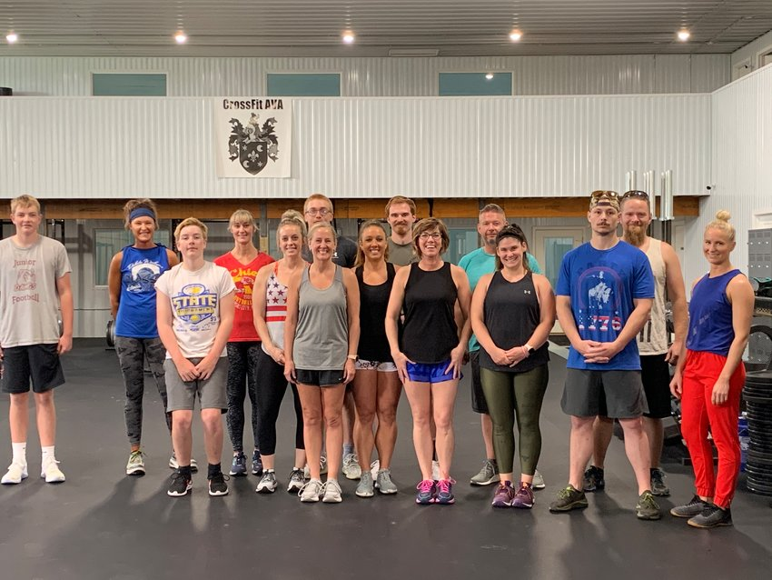 "Participants come together for the annual Murph Challenge. Cross-Fit AVA does not require you to be a member to participate at their gym. They have a ""drop-in"" rate of $15. To see what they offer and their prices, go to https://crossfit-ava.com/. (Pictured back row, left to right) Blake Van Regenmorter, Sheila Schmidt, Darcie Tolzin, Devin Krup, Derek Lund, Terry Schmidt, Kennedy Longville. (Front row, left to right) Trace Van Regenmorter, Callie Aylward, Jennifer Malone, April Peterson, Amy Kruse, Laurie Bunker, Austin Aylward (co-owner), Victoria Albrecht (co-owner)."