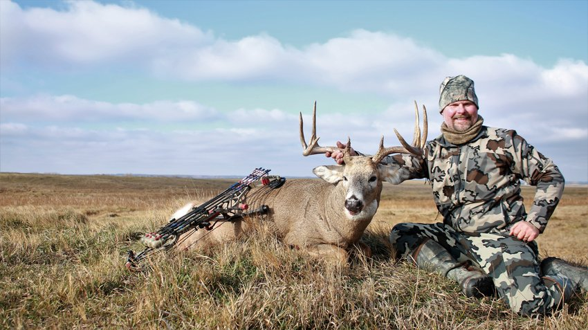 Taking advantage of the time and perspective the offseason months provide is as important as the hunt itself, says the author, pictured here with a dandy whitetail.