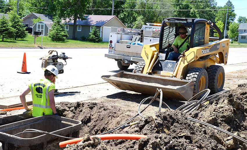 A drop crew from Engbarth Directional works along Highway 14 in Lake Preston on June 11 to bury fiberoptic cable lines for Valley FiberCom, a company that is bringing new cable, internet and phone services to communities in Kingsbury County.