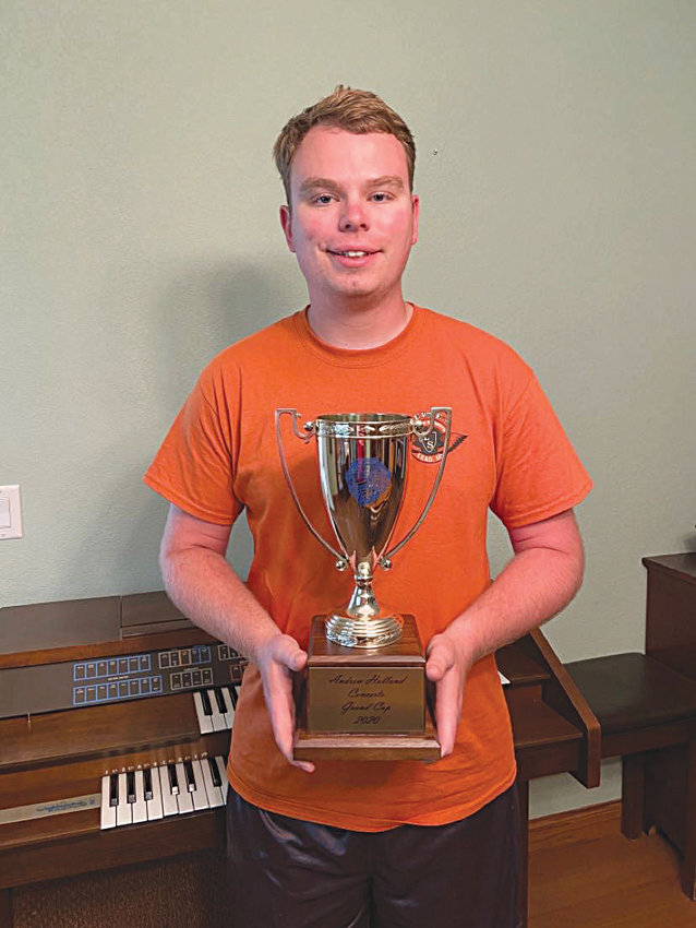 Grand Cup Winner: Andrew Holland poses with the Grand Cup he received during the Junior Piano Festival in De Smet this year. Gold cups are awarded to piano students through a point system, ranging through 3-year, 6-year, 9-year, 12-year, Grand and President cups.