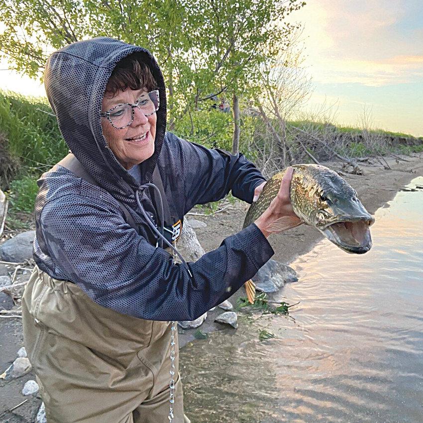 Patti Slater handles a true Lake Henry hog!