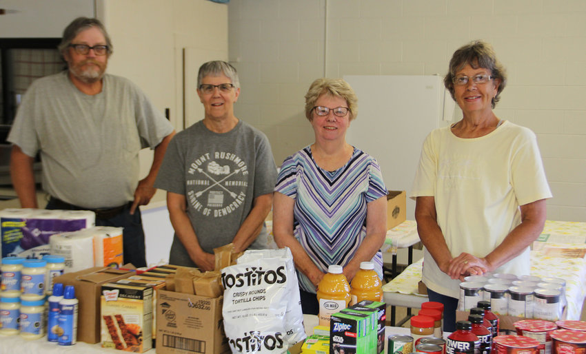 This group of volunteers is instrumental in running the food bank in the Oldham area; Paul Johnson, left, Sheila Huntimer, Sandy Smith and Cathy Folsland. Brad Folsland is not shown.