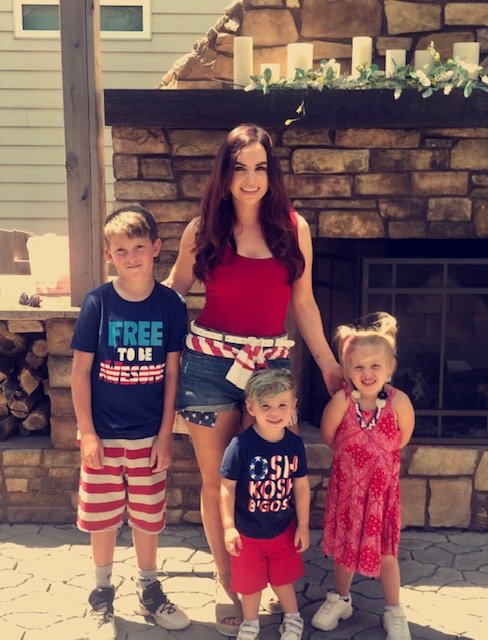 Lacey Cooper, shown with children Dalton, left, Beckham and Aspen, will soon be opening a daycare facility in De Smet.