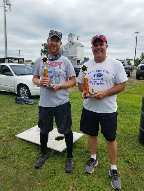 Beanbag champs: Scott Beehler, left, and Mike Ruth display their winning trophy following the beanbag tournament.
