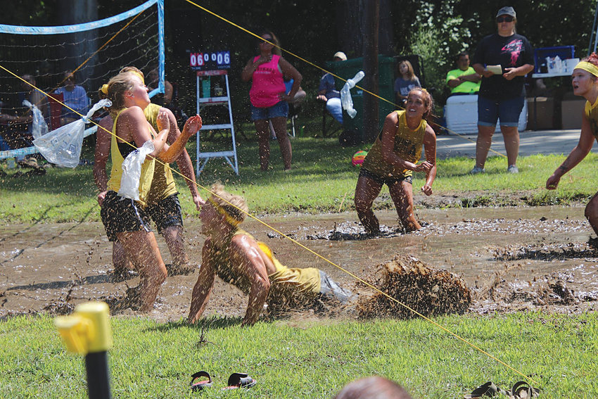 Muddy fun: Former De Smet students who got in on the mud volleyball fun Aug. 2 in Carthage include Sarah Urevig, left, Baylor Beck, Lucas Urevig, Reyna Beck and Codi Schmidt.