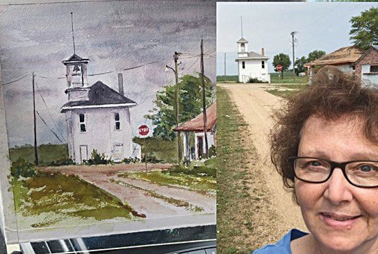 """Joy Halling of Watertown takes a selfie with her artwork. She won the People's Choice Award with her painting titled """"Lily Town Hall."""""""