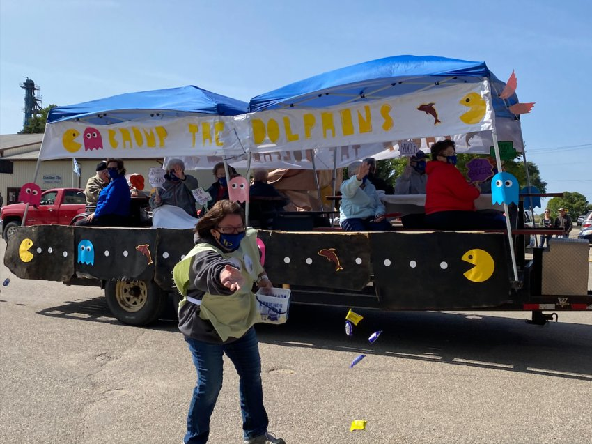 The Silver Plains Assisted Living float was one of the many clever floats. Becky Cass is throwing some candy to enthusiastic candy lovers.