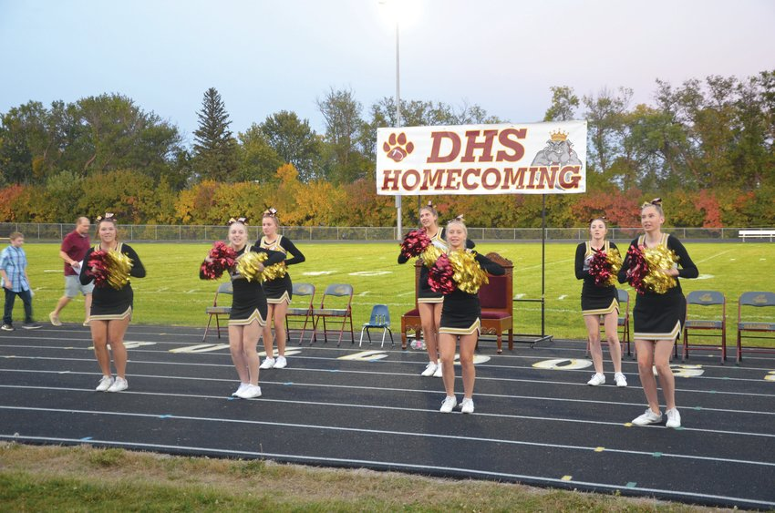 Cheerleaders Olivia Johnson, rear left, Kennadi Buchholz and Jacie McCune; Shelby Sattler, front left, Riley Myers, Kendra Palmlund and Leah Millman prepare to fire up the crowd during coronation. Bella Kretzschmar and Heaven Bachelle are also on the squad.