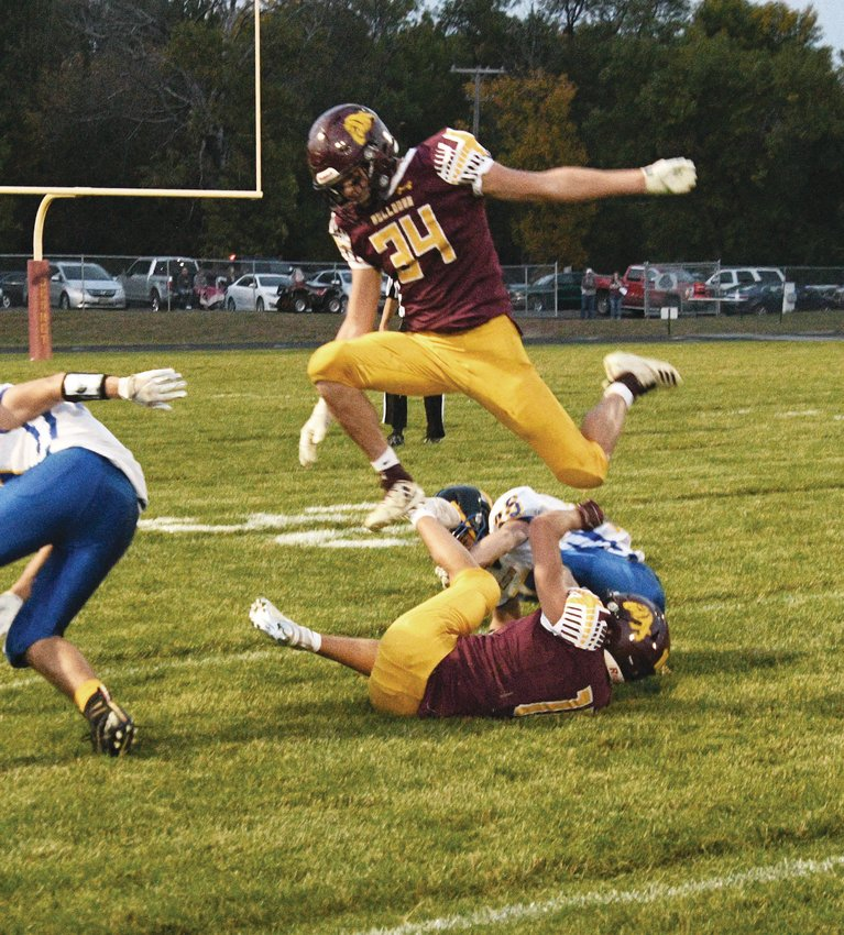Tory Holland hurdles the pile during the homecoming game Friday night in De Smet.