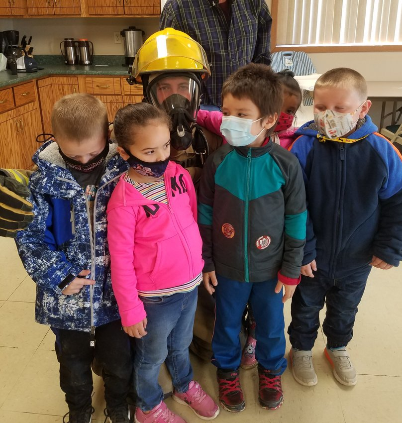 Iroquois elementary school students visited the fire station last week for fire prevention week. They learned about fire safety and toured the fire trucks. Students shown with firefighter Matthew Penner are  preschoolers Christopher Dorris, left, Elienai Hernandez, Enrique Siu Hansen, Sarai Hernandez and Nathan Wipf.