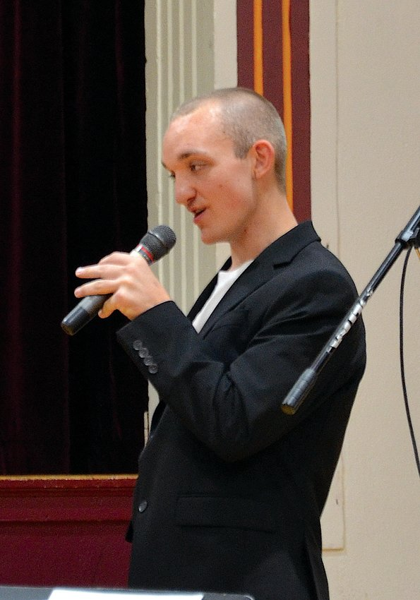 """Senior Andrew Close sings his rendition of Scotty McCreery's country ballad """"I Love You This Big"""" Monday evening during the De Smet High School and Middle School Pops Concert."""