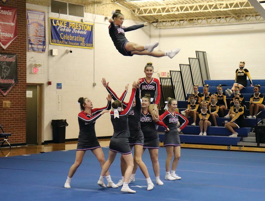Right: Badger cheerleaders perform a stunt during their competition on Monday afternoon.