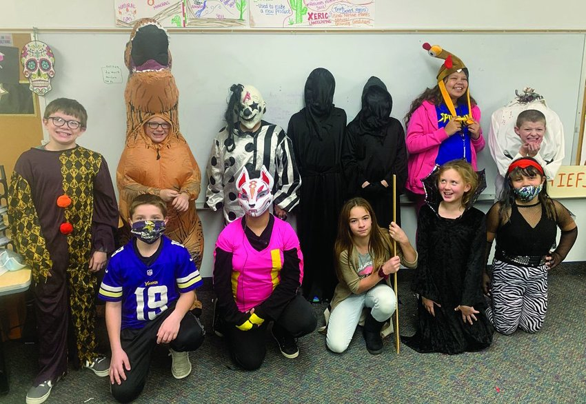 The Iroquois sixth grade class enjoy Halloween by dressing up in their costumes.