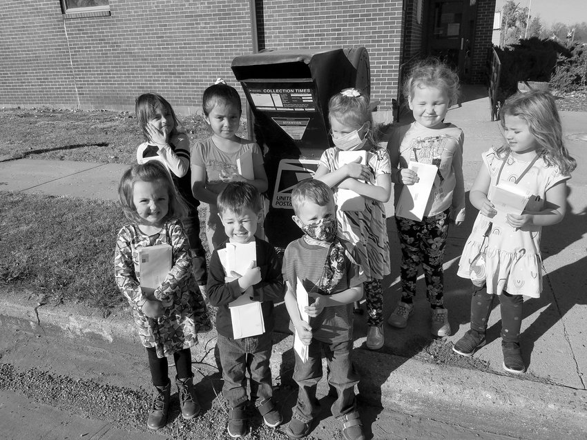 This preschool class took advantage of the nice weather to walk to the post office and mail letters to veterans, inviting them to the school's program Nov. 11. Participants include Lanna Fischback, back left, Sarai Hernandez, Rina Frankfurth, Jessa Hanson, Jordyn Van Diepen; Savannah Driggers, front left, Preston Huls, and Micah Blue.