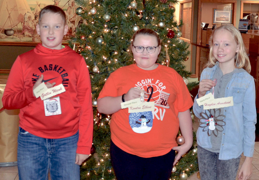 Each year, American Bank & Trust in De Smet sponsors a Christmas tree ornament-making contest for fifth-grade students at Laura Ingalls Wilder Elementary School. This year's winners are Gatlin Wienk, left, first place, who won $25; Kendra Elkins, second place, $15; and Hayden Armstead, third place, $10. Each of Jennifer Hojer's students also received a gift certificate from The Cowboy Country Store for a free hot chocolate and a personal size pizza.