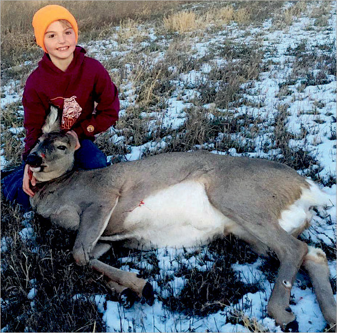 Sutton Bjorkman of De Smet shot his first deer with his dad, Nick. Sutton was very proud to use his grandpa John's rifle. Great shot!