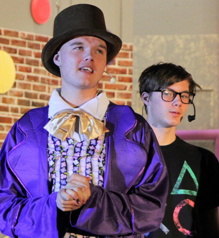 Willy Wonka, foreground, is portrayed by Gunner Larson, while Mike Teevee, a boy obsessed with television and electronics, is played by AJ Wienk.