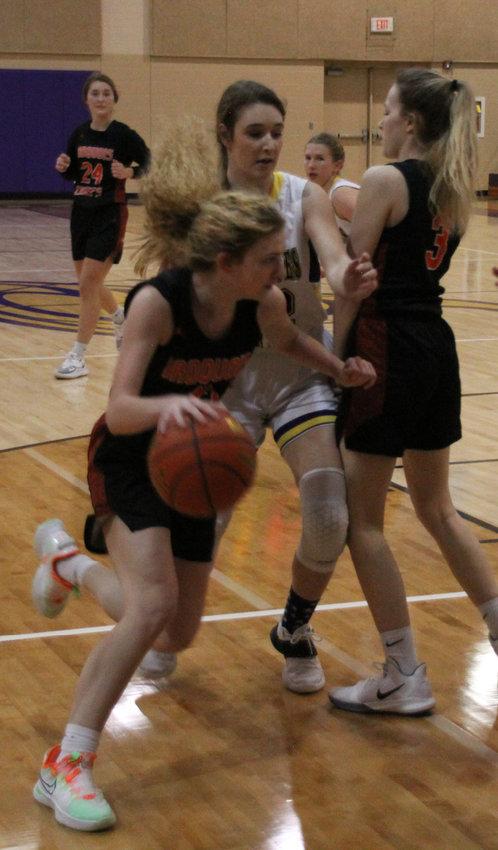 Anna Decker drives the ball to the basket.