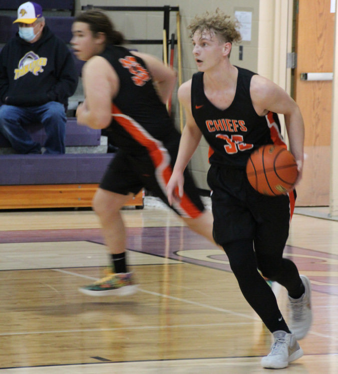 Keith Hagen, left, and Cole Nelson dribble the ball up the court against Centerville last week.