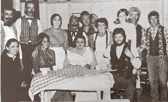 """Pictured is the cast of """"The Long Winter"""" that was performed in 1971. Mrs. Milo Apland, seated left, Jackie Hannah, Mrs. Clayton Abrahamson, and Milo Apland, Dialo Schmidt, standing left, Glen Hassebroek, Patty Peckenpaugh, Howard Schultz, Delmer Wolkow, Patti Ward, Roxene Thaden, Arnold Poppen and Mike Pollock all pose for a picture after a performance."""