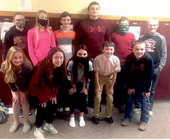 Students who participated in the reading challenge include Audi Currier, rear left, Hazel Luethmers, Chase Temme, Grant Wilkinson, Chauncey Driscoll and Breyten Johnson; Brooklyn Coughlin, front left, Arianna Larson, Megan Dylla, Danny Sudenga and Lane Albrecht. Blake Jennings and Logan Nielsen are not shown.