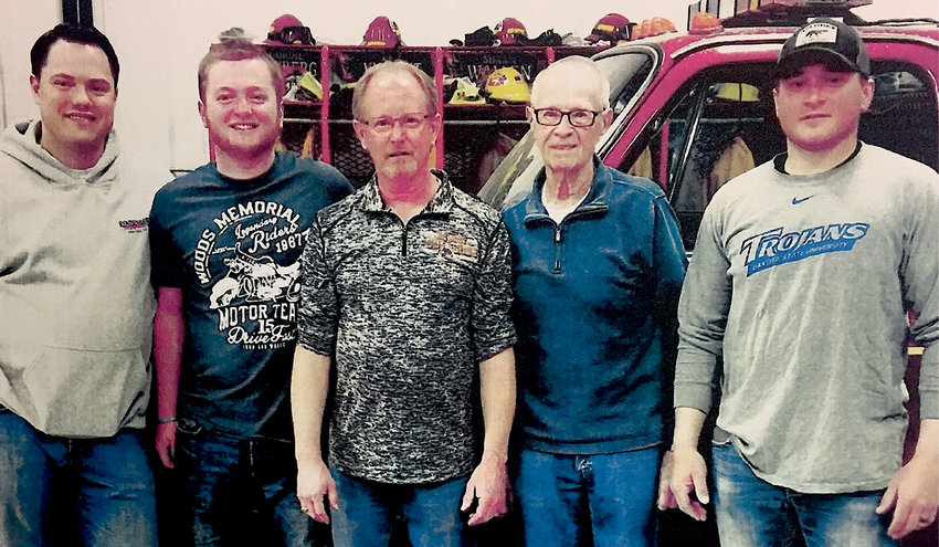 Three generations of the Munger family have served on the De Smet Volunteer Fire Department. Craig Munger, second from right, and his son Steven, center, are retired from the department. Steve's son-in-law Nick Henrich, left, and sons Tate and Cole Munger are current members.
