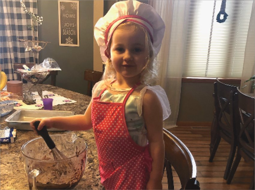 Chef Spencer Warne, 2-year-old daughter of Kris and Amber Warne, spends cold winter days in the kitchen, making brownies for Grandma and Grandpa.