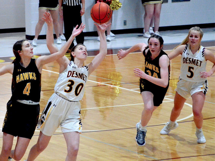 De Smet's Ella Poppinga (30) and Colman-Egan's Hailey Larson (4) fight for control of the ball Jan. 29 at De Smet, while Josie Mousel (14) and Emma Albrecht (5) are ready to assist.