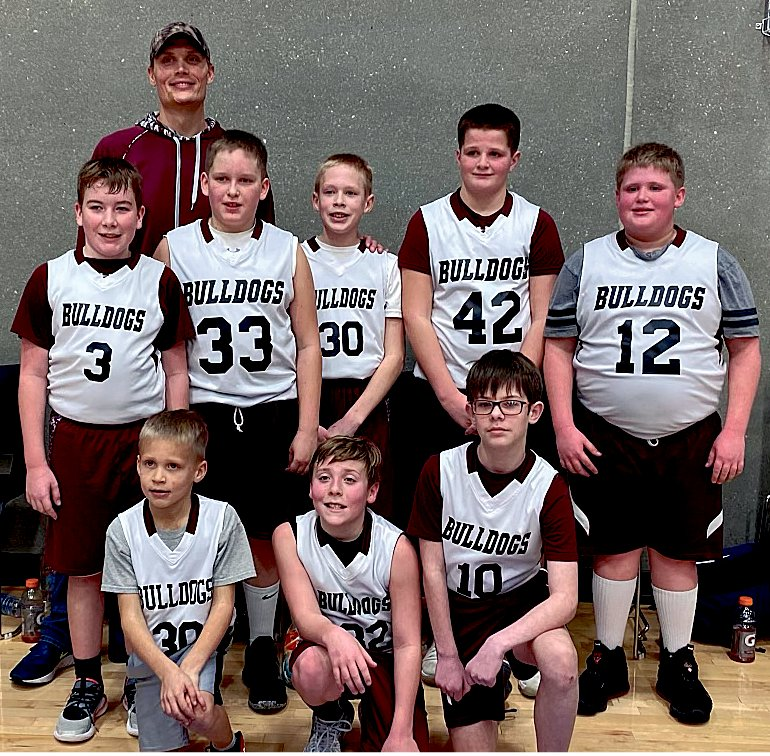 Sixth grade boys wrapped up their season on Feb. 6 at a Watertown tournament. Coach Mike Luethmers, back left, Coy Van Regenmorter, Gatlin Wienk, Noah Luethmers, Carter Wilkinson and Trace Rowcliffe. Jacob Luethmers, front left, Jordan Botkin and Eli Hubbard. Not pictured is Gradyn Henrich.