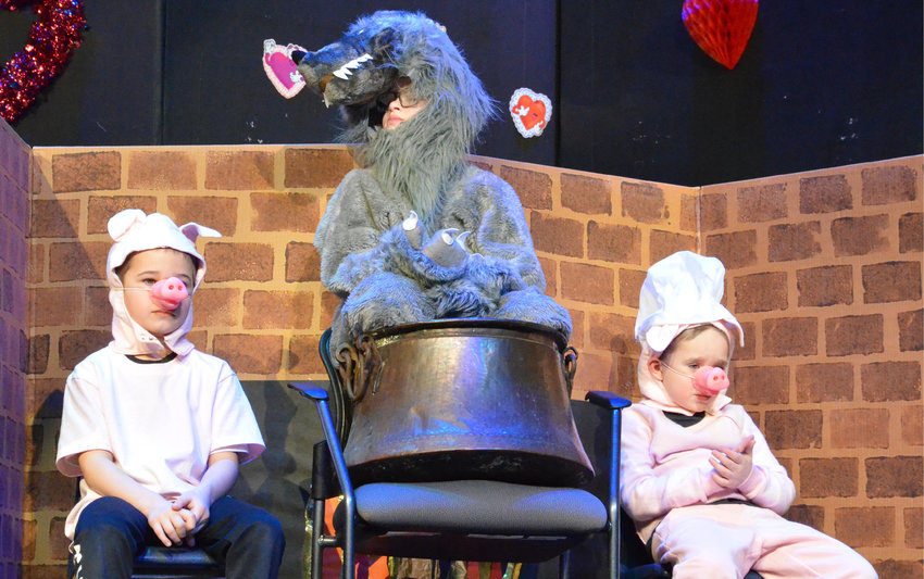 The De Smet kindergarten Valentine play on Feb. 11 featured Michael Dylla, left, and Logan Springer as the pigs and Jaden Hojer as the wolf, in the hot seat. See more photos on page 14.