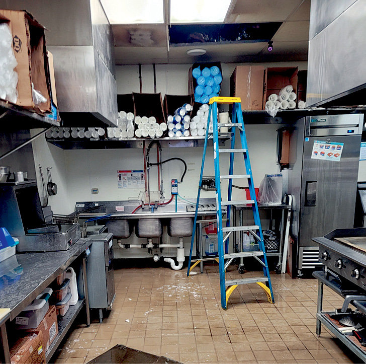 Many pictures of Dairy Queen's burst pipe incident were taken for insurance purposes, including this photo of damage in the kitchen.