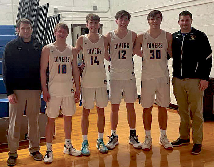 The seniors on the boys' basketball team have been playing together since the fourth grade. Coach Dufek, left, Tate Larsen, Rhett McMasters, Carter Malone, Jasper Denison and Coach Solberg pose for a picture after the game.
