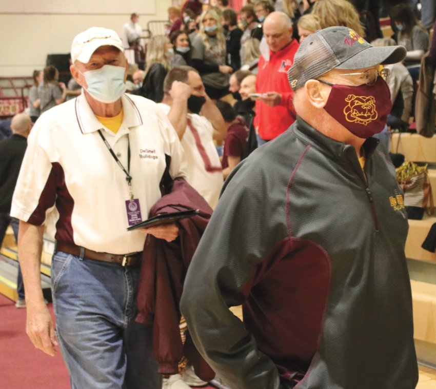 Not their first rodeo:  Longtime De Smet coach and athletic director Marv McCune (right) arrives at the Boys State B championship game March 20, accompanied by his friend and fellow Bulldog fan Bernie Stoel. It was Stoel in the summer of '78 who gave McCune a heads up about a teaching and coaching position opening up in his hometown. The rest, as they say, is history.